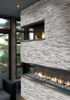 Stacked Stone Ledger panels are trimmed pieces of natural stone affixed together to form modular stone veneer panels which allows for the streamlined installation of a dry stacking stone veneer. Fireplace Wall, Fireplace Design, Whitewash Stone Fireplace, Fireplace Ideas, Double Fireplace, Ledger Stone Fireplace, Modern Stone Fireplace, White Stone Fireplaces, Fireplace Gallery