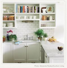 Open cabinets and subway tile.
