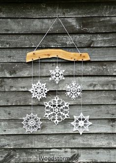 Holiday decor  crochet snowflake and wood ornament by Woodstorming, €45.00