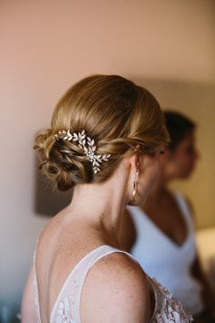 Low bun with a glam hair accessory: http://www.stylemepretty.com/2014/12/29/colorful-summer-wedding-at-ojai-valley-inn/ | Photography: Marianne Wilson - http://www.mariannewilsonphotography.com/
