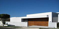 Modern Garage Doors Design | ... Modern House Exterior Design With Concrete Fence And Wooden Garage