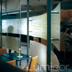 Lumicor's Coastal panels utilized as a bar partition