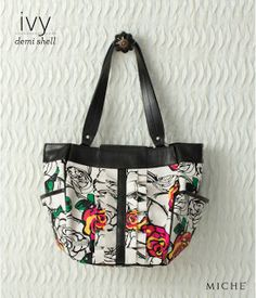 The Ivy Shell for the Demi Bag is like being in an enchanted garden, complete with abstract rose print in bold shades of red, pink, yellow and green.  Tuxedo ruffles on the front and black trim details add just the right amount of sophistication to this unique Shell. Where ever you are going you'll look stunning.