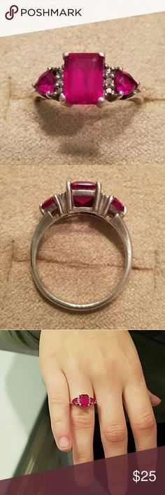 Ruby 3-Stone Ring Stamped sterling ring has emerald cut center stone flanked by trillions and accent stones. Prong-set created ruby stones are secure. Perfect for those July birthday girls! Size 7 #birthstonering #sterling #925 #ruby Jewelry Rings