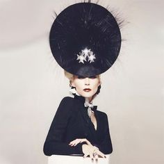 Daphne Guiness in a Philip Treacy hat, via a White Carousel blog