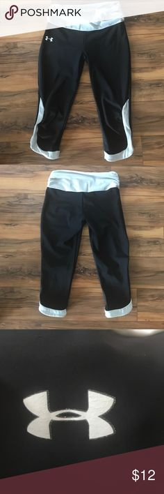 Black/White Athletic Leggings Black/white detail/ 87% nylon/13% elastane/17 inch inseam/22 3/4 inch outer seam/scrunched elastic waist/size medium but fits VERY tight, more like a small or xs/Under Armour emblem is slightly cracked from wear & tear Under Armour Other