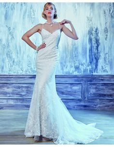 Fabulous fitted gown available at Spotlight Formal Wear! #SpotlightBridal