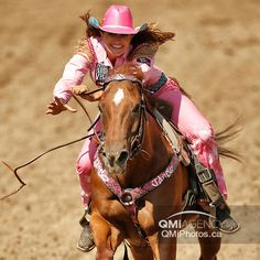 Fallon Taylor of Whitesboro, Texas, in the barrel racing event during the Calgary Stampede rodeo in Calgary, Alta. on Saturday July 12, 2014. Al Charest/Calgary Sun/QMI Agency