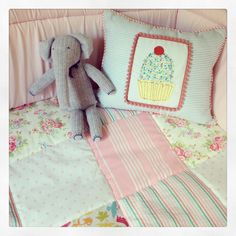 Love the vintage feel on this pillow and comforter for our baby girl