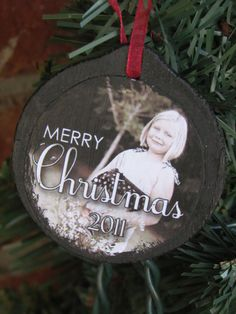 paint flat wooden ornament and mod podge picture onto ornament... add ribbon... voila!