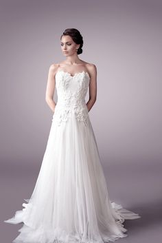 The soft princess strapless fuller gown only at http://www.faraweddingdress.com.au .