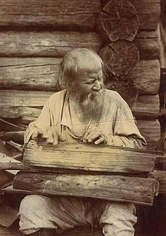 "Blind musician who plays ""Kantele"" - kind of the psaltery. Karels  Russian Museum of Ethnography"