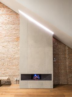 Living Room, Dark Hardwood Floor, Gas Burning Fireplace, Recessed Lighting, and Bench The concrete f Fireplace Beam, Fireplace Lighting, Craftsman Fireplace, Cottage Fireplace, Fireplace Bookshelves, Limestone Fireplace, Concrete Fireplace, Farmhouse Fireplace, Fireplace Outdoor