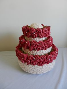 Raymond Hudd hat of roses on cake