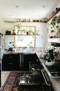 kitchen styling and renovation inspiration - open shelving across the window, black cabinets