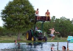one more good use for a tractor :) llol    Not letting my son and his friends see this!