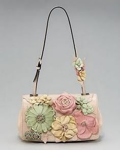 """Fix up any """"blah"""" purse by adding some cute flowers or even bows.. Great way to update old things and make them new!"""