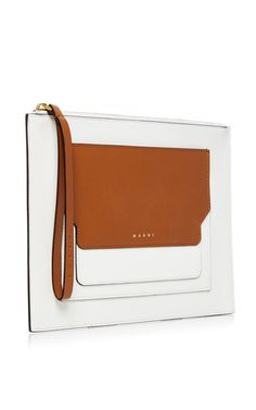 Crafted in premium calf leather, this **Marni** pochette features a two-toned body with canvas lining and internal card pockets.