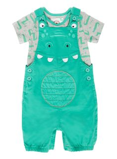 This cute set is perfect for everyday wear. In green with a fun crocodile design, this set features a pair of bib shorts with elasticated cuffed legs and a super soft short-sleeved vest with popper button fastenings for easy changing.<br /><ul><li>Boys green crocodile bib shorts set</li><li>Short-sleeved vest</li><li>Popper button fastenings</li><li>Elasticated cuffed legs</li><li>Keep away from fire</li></ul>