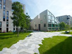 Funenpark by LANDLAB The paths consist only of two different pentagon-shaped concrete paving stones, in three shades of grey.