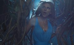 """After the release of Taylor Swift's """"Out of the Woods"""" music video, directorJoseph Kahn revealed behind-the-scenes photos from her icy shoot."""
