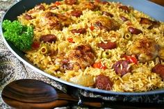 Arroz con  pollo, w/chorizo, cebolla, haceituna, pimientos rojos