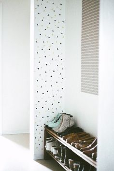 Pretty triangle confetti wall decor! Love the idea of using washi tape to decorate a wall http://www.hearthandmade.co.uk/washi-tape-wall-decor/