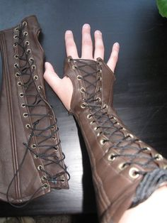 These laced up gloves look like they were made from old boots. Great idea.