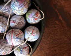 Flaunt your penchant for globe-trotting with this map-ball garland. #etsy #etsyfinds
