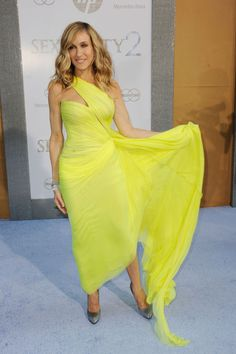 May 24 2010 In a Valentino couture neon yellow asymmetric dress for the Sex And The City 2 world premiere in New York.