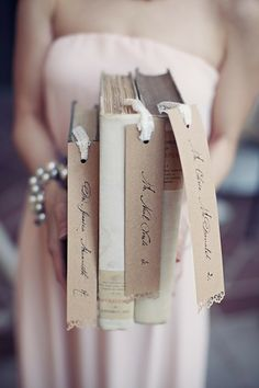How clever! Bookmark #PlaceCards held in a #TableNumber Book I A Good Affair Wedding and Event Production I #uniqueweddingideas