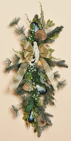 Frosted teal greenery, adorned with natural champagne and white shells is as magical as our wondrous mermaid.  AWESOME for Christmas!
