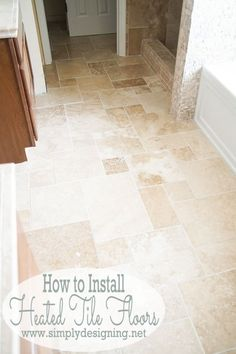 DIY Heated Tile Floors - you won't believe how simple it really is to DIY heated tile floors in your home!  Stop by to get the complete tutorial on how to install radiant heat system in your floors and then install beautiful travertine tile!  It will completely transform your bathroom!