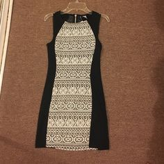 Black and white pattern dress Black dress with black and white center pattern detail, cute for going out. Size 4 but fits like a 0. Dresses Mini