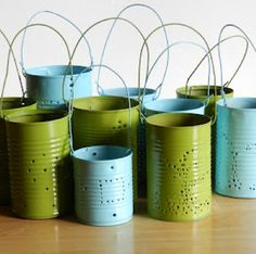 Repurpose Tin Cans.  Going to make a grouping of these sans handles for the back patio dining table.  (: