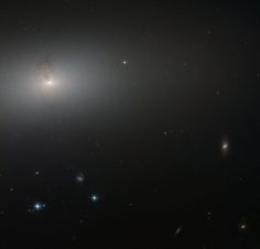 https://flic.kr/p/BECRzd | Hubble Peers Through the Elliptical Haze | Like a lighthouse in the fog, the luminous core of NGC 2768 slowly fades outwards to a dull white haze in this image taken by the NASA/ESA Hubble Space Telescope.  NGC 2768 is an elliptical galaxy in the constellation of Ursa Major (The Great Bear). It is a huge bundle of stars, dominated by a bright central region, where a supermassive black hole feasts on a constant stream of gas and dust being fed to it by its galactic…