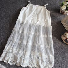 Timeless classic White tank with delicate Ivory lace ruffle bottom hem detail. Perfect worn alone, under a top/tunic as a slip extender or