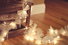 Tying squares of lace and tulle to strings of lights. so cute!