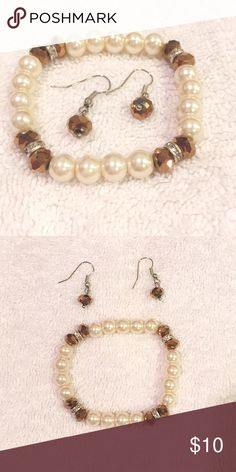 Pearl and brown gems bracelet & earrings set Pearl and brown gems bracelet & earrings set. Stretchable bracelet. Lightweight earrings. Brand new, never worn. Sorry, no trades. Like the item but not the price, feel free to make me a reasonable offer using the offer button below. Jewelry Bracelets