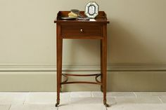 The Eclectic Bedside Water Table has the simple, elegant lines that are typical of the Georgian era. Made from solid timber, it has one drawer, an antiqued brass pull knob and wheeled castors. Wooden Furniture, New Furniture, Bedroom Furniture, Metal Bedsteads, Bedside Chest, Bedside Tables, Lay Me Down, Georgian Era, Elegant