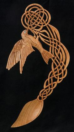 The Swallow shows a stylized bird delicately perched on a Celtic flower and stem. The knotwork bends slightly to accommodate the weight of the bird and gives the spoon lots of vibrant life.