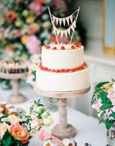 white wedding cake raspberries