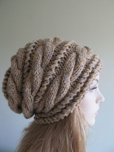 This is a hand made knitted slouchy braided cable hat, or beanie that made of soft chunky acrylic and wool yarn blend in the natural mixed of Grey & Beige colors. Its loose-fitted, thick and comfortable. Its a great cold season accessory.   Thank you so much for stopping by, please check out my other hats and berets: http://www.etsy.com/shop/Lacywork?section_id=11219415   Have a great day.