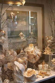 I love this look of all the shells in the apothecary jars.
