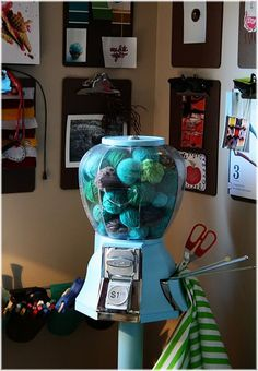 Gumball machine filled with yarn! I happen to have an empty gumball machine waiting to be fantastic... I thought about filling it with yarn scraps... but this is cute!
