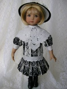 I've dressed another old fashioned girl - this one took lots of planning with the stripes, and using a vintage hankie :)