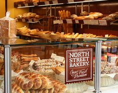 Bakery branding and front display.  Glass on the top, not just sides.