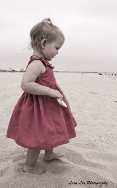 Precious little girl caught on camera while shooting a Pregnancy Photoshoot. -  Captured by Lara Lux Photography in NJ.  Check out www.laralux.com to book your shoot today!  Serving NJ, NY, Pennsylvania, and Connecticut. #FamilyPortrait #PregnancyPhotoshoot #bellypictures #LaraLuxPhotography #beach #ocean