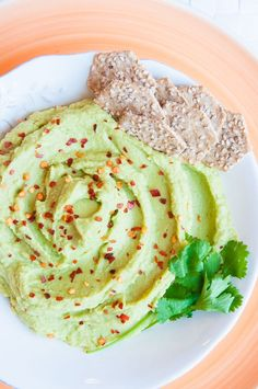 Avocado Hummus Recipe - An easy avocado hummus recipe without tahini! This healthy hummus is oil-free and made delicious with avocado and cilantro!