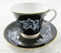 Aynsley Black Tea Cup and Saucer with White Rose by TheAcreage